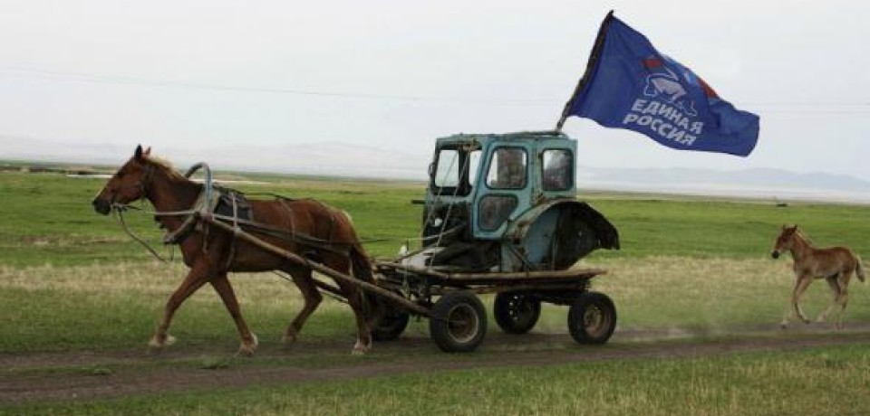 Putin's United Russia party campaigning in a Russian village: the horse-drawn cart reusing the cabin from a dismantled tractor prominently displays its flag wherever it goes (Image: rufabula.ru)