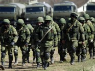 "Russian ""green men"" occupation force surrounding a Ukrainian military base in Perevalne, Crimea, in March 2014."