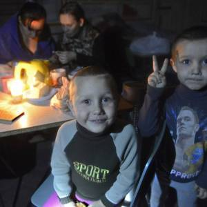 Families with children in a bomb shelter in Donetsk hiding from artillery shelling as result of the Russian military aggression in the Donbas, Ukraine (Image: A. Umanets / Segodnya.ua)