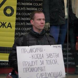 "Anti-Putin protester Ildar Dadin received 3 years of prison for 4 peaceful single-person protests including the one in the photo. His sign says ""Stay Quiet -- Then When They Will Come for You Tomorrow, the Next Will Stay Quiet about You."" (Image: Social media)"