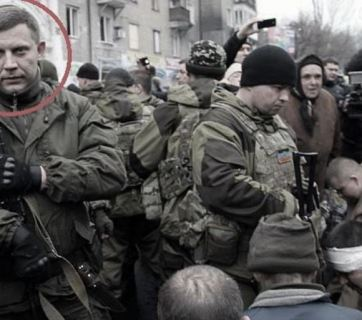 "Aleksandr Zakharchenko [20] during public humiliation of the ""Cyborgs"" on the streets of Donetsk. Photo from the report"