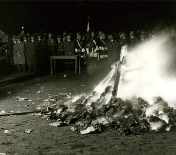 The ominous image featured in Maxim's article combines an infamous photograph of book burning in Hitler's Germany of the 1930's with a photograph of a modern Russian male, the target audience of the magazine (Image: maximonline.ru)