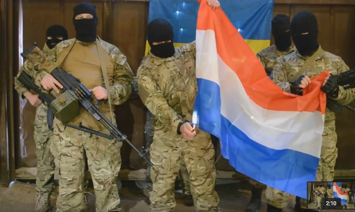 Fake Azov battalion members burning the Dutch flag. Screenshot of a YouTube video