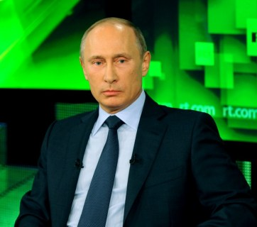 Vladimir Putin giving an interview to Russian propaganda TV channel Russia Today