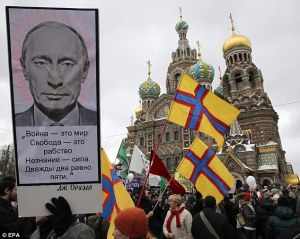 "The Putin poster at a demonstration in Moscow quotes George Orwell's ""War is Peace, Freedom is Slavery, Ignorance is Strength."" (Image: EPA)"