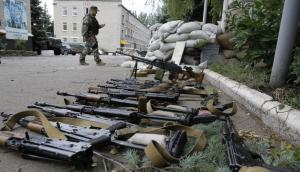 Weapons captured by the Russian special forces and mercenaries after the fall of a Ukrainian military base. Donetsk, Ukraine, 27 June, 2014. (Image: Dmitry Lovetsky, AP/Scanpix/LETA)