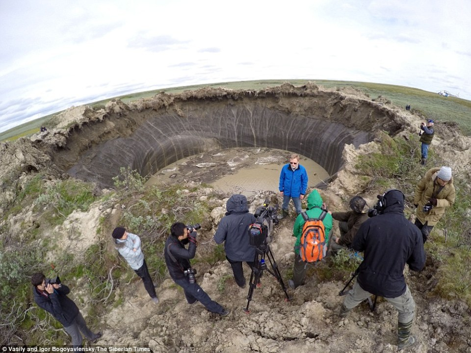 The mysterious giant craters that caused a minor media sensation after they started to appear in the Russian Far North a few years ago have also been tied to effects of the melting permafrost (Image: Vasily and Igor Bogoyavlensky, The Siberian Times)