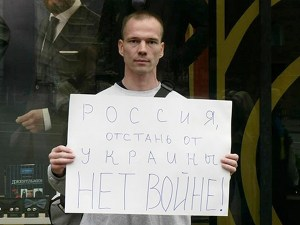 "Anti-Putin protester Ildar Dadin received 3 years of prison for 4 peaceful single-person protests in Moscow including the one in the photo. His sign says ""Russia - get off of Ukraine! No to the war!"" (Image: Social media)"
