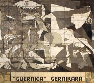 "Mural of the painting ""Guernica"" by Picasso depicting the carpet bombing of the Basque town of Guernica during the Spanish Civil War. It was carried out at the behest of the Spanish nationalist government by its allies, the Nazi German Luftwaffe's Condor Legion and the Fascist Italian Aviazione Legionaria, under the code name Operation Rügen on 26 April 1937. The attack gained infamy because it involved the deliberate targeting of civilians by a military air force, just as it was done by the Russian and Syrian government military air forces in Aleppo. Location: Guernica, Spain (Image: Papamanila via Wikipedia)"