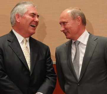 Sharing a laugh: Vladimir Putin with ExxonMobil CEO Rex Tillerson, Donald Trump's pick for US secretary of state, the nation's highest diplomatic post. (Image: Getty Images/Sasha Mordovets)