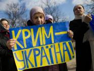 Tatar Crimeans attend a pro-Ukraine rally in Simferopol, March 14, 2014