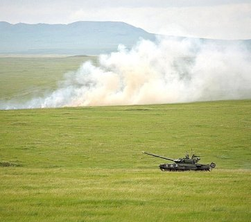 A Russian tank participates in military exercises in 2013. Photo via kremlin.ru