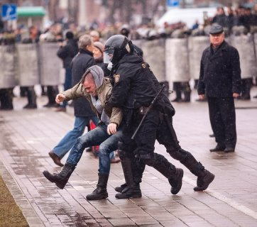 The police detains a protester in Minsk, Belarus on March 25, 2017. (Credit: Tut.by)