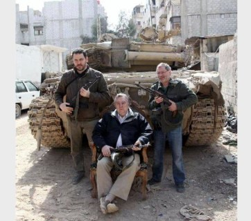 Putin's propagandists (L-R) Maksim Shevchenko, Aleksandr Prokhanov and Mikhail Leontyev posing with Kalashnikov assault rifles in Syria, the country where Russian bombings have killed more civilians than ISIS has. (Image: social media)