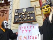 "Activists in monster costumes held a protest hear the building of the Supreme Court, holding a sign saying ""This is no place for evil spirits."" Photo: censor.net.ua"