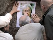 Participants of a rally in memory of Anna Politkovskaya attach her portrait to the streets in St.Petersburg. Photo: RIA Novosti