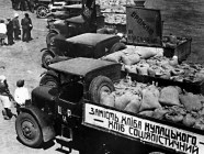 "A flashback from 1933, when confiscation of grain from Ukrainian farmers led to their starvation during the Holodomor. Sign on the truck reads ""Socialist bread instead of ""kurkul"" bread"", Ukraine, 1933"