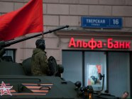 A Russian military vehicle in front of an Alfa-Bank office in Moscow, Russia (Image: vedomosti.ru)