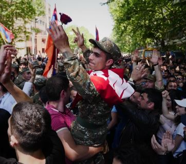 On 23 April, soldiers joined the protests. Here, a soldier who has joined protests in Yerevan is carried above the crowd. Photo: Amos Chapple, RFE/RL