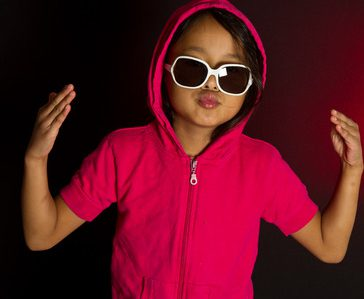 52447392 - girl with sunglassesplaying smart in red