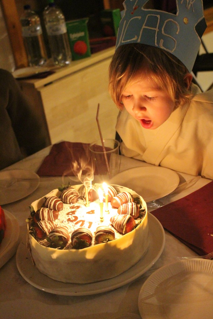 4 year old blowing out candles
