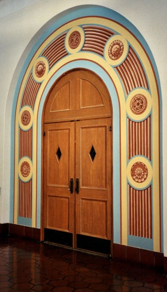 Trompe l'oeil doors add a sense of ceremony for students