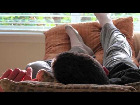 man asleep on sofa