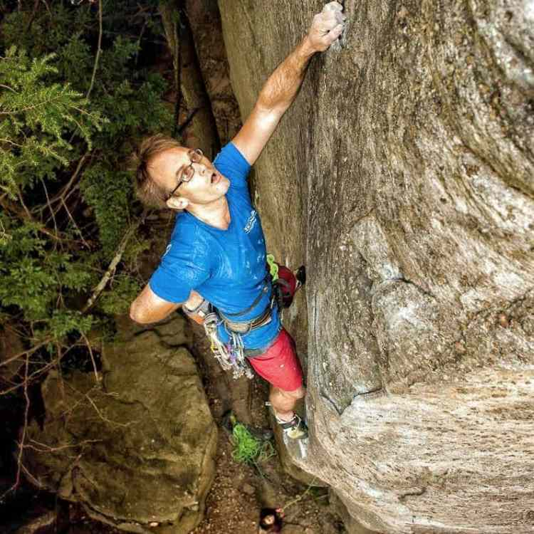"""The author on the FA of """"Are You an Idiot?"""" (5.12 R).  Photo: Dan Brayak"""