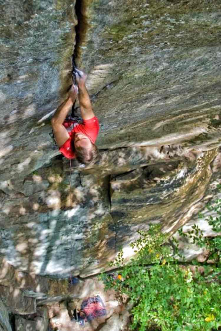 The author on the Red River Gorge's classic hard splitter, Welcome to Ol' Kentucky (5.13a). Photo: Tristan Croll