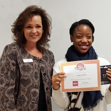 BB&T Associate Cindi Shaddix presents winning student Tytiana with her award.
