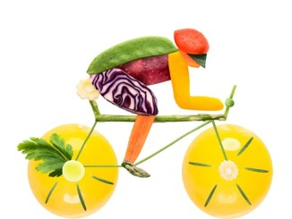 Fruits and vegetables in the shape of a male cyclist on a road bike.