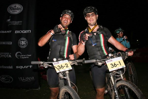 Tonie Bouwer and Wim Hiddema celebrate completing this year's 36ONE MTB Challenge, illuminated by their Extreme Lights bike lights. Photo by Oakpics.com