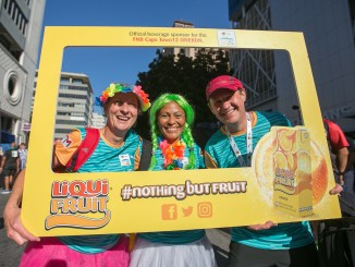 Liqui-Fruit, the juice that everyone reaches for first, has teamed up with two premiere road running events, the FNB Joburg 10K CITYRUN and the FNB Durban 10K CITYSURFRUN.  Runners (and walkers) can look forward to enjoying Liqui-Fruit's extensive range of fruit juices both on route and at the finish.  Seen here (earlier this year):  Entrants having fun with Liqui-Fruit on route at the FNB Cape Town  12 ONERUN, sister event of the FNB Joburg 10K CITYRUN and the FNB Durban 10K CITYSURFRUN.  Photo Credit:  Mark Sampson