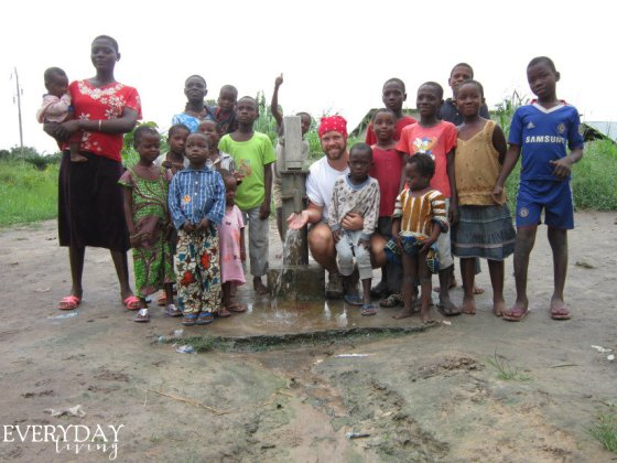 Seth with some of the children enjoying their clean water!