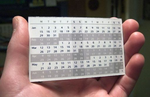 Hand holding small calendar