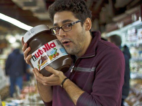 Man holding large Nutella jar
