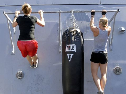 Two women doing pull-ups