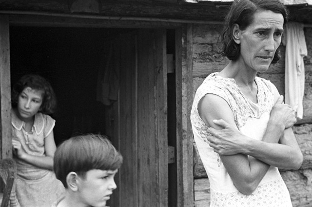 Family of a Resettlement Administration client in the doorway of their home in Boone County, Arkansas