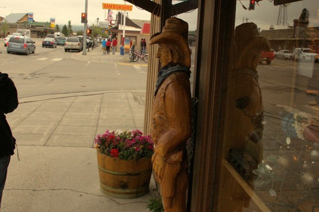 carved wood cowboy sculpture, West Yellowstone, Montana, August 20, 2014