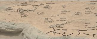 Superposición de dibujo en la fotografía de arriba para ayudar en la identificación de las estructuras en la superficie del lecho de roca.