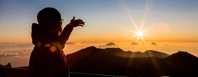 J admiring the sunrise on Mount Haleakala in Maui