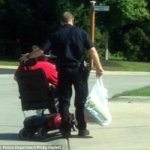 Breaking News – This Police Officer is Actually HELPING Someone