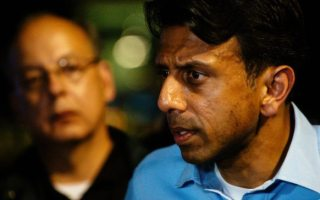 Louisiana Gov. Bobby Jindal speaks with the media following a deadly shooting at the Grand Theatre in Lafayette, La., Thursday, July 23, 2015. (AP Photo/Denny Culbert)
