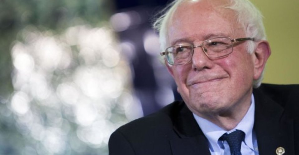 "Senator Bernie Sanders, an independent from Vermont and 2016 Democratic presidential candidate, smiles during an interfaith roundtable in Washington, D.C., U.S., on Wednesday, Dec. 16, 2015. Sanders said figures like Trump attempt to ""divide"" Americans. ""A few months ago we're supposed to hate Mexicans and he thinks they're all criminals and rapists and now we're supposed to hate Muslims, and that kind of crap is not going to work in the United States of America,"" he said. Photographer: Drew Angerer/Bloomberg via Getty Images"