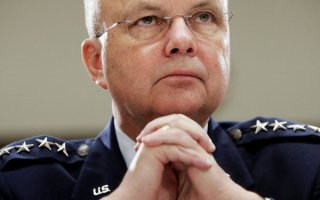 """WASHINGTON - JANUARY 18:  Central Intelligence Agency Director Michael Hayden listens to questioning during a hearing before the House Intelligence Committee January 18, 2007 on Capitol Hill in Washington, DC. The topic of the hearing was the """"Current Assessment of Threats to U.S. National Security.""""  (Photo by Win McNamee/Getty Images)"""
