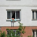 "Woman ""Sunbathes"" By Hanging Her Naked Butt Outside Her Window – PIC"