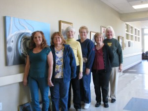 A new art exhibit by the North Central Arkansas Artist League was hung Jan. 13 by (from left) Mary Shelton, Cabot; Connie Hood, Fairfield Bay; Carolyn Goettsch, Edgemont; Ellen Kelly, Fairfield Bay; Joan Bland, Clinton; and Joyce Hartmann, Choctaw.