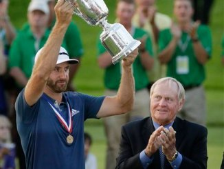Dustin Johnson holds the trophy as Jack Nicklaus looks on after winning the U.S. Open golf championship at Oakmont Country Club on Sunday, June 19, 2016, in Oakmont, Pa. (AP Photo/Gene J. Puskar)