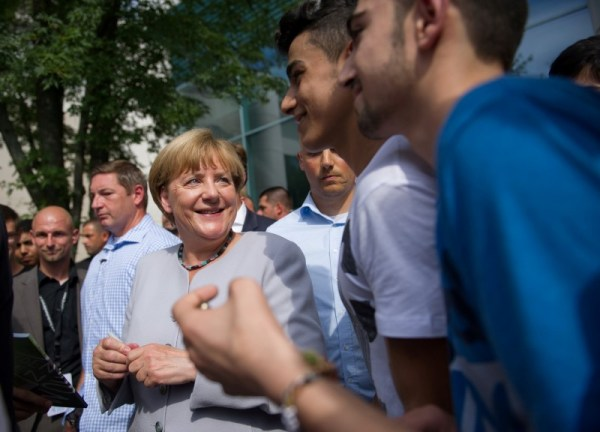 German Chancellor Angela Merkel meets visitors on tour during the open day at the Federal Chancellery in Berlin, Germany August 28, 2016. REUTERS/Stefanie Loos