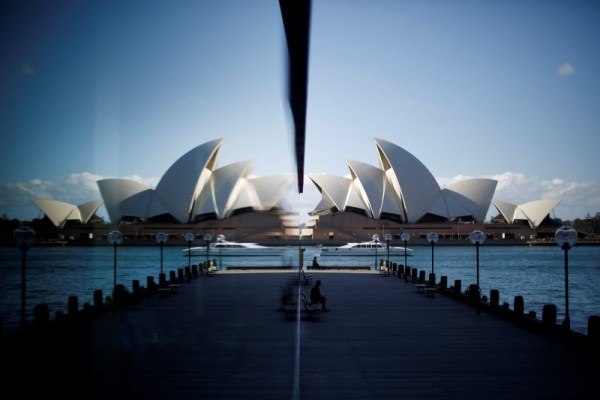The Sydney Opera House is reflected in a harbourside hotel window in The Rocks district of Sydney, May 7, 2014.      REUTERS/Jason Reed/File Photo